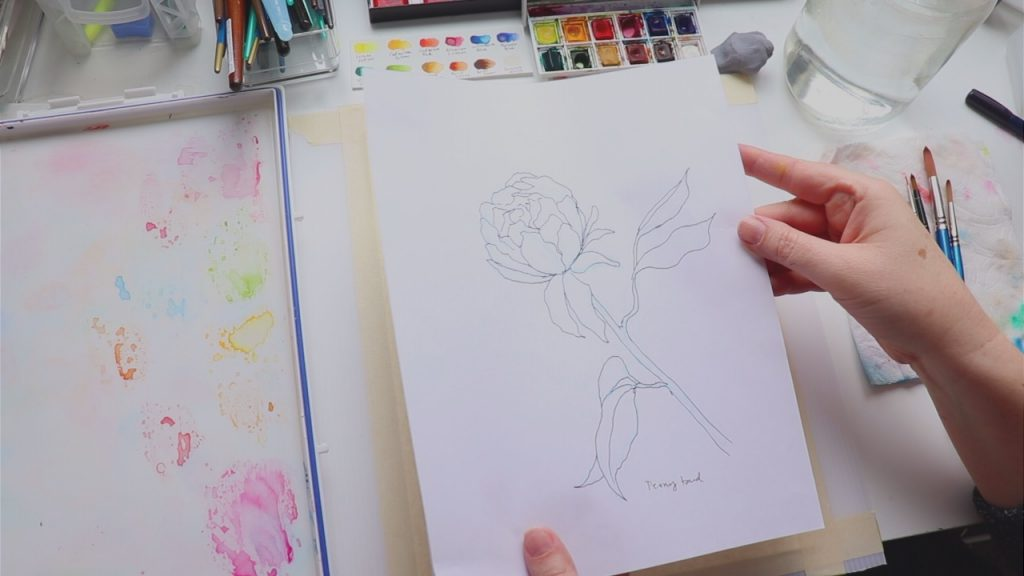 Hannah from Lily and Thistle is holding the pattern for her watercolor flower tutorial. This is step one of her step by step tutorial for beginners.